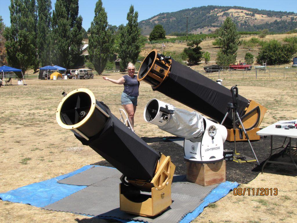 "Sandy Eulitt showcasing her 28"" Big Dob telescope SkyClops, 12"" dobsonian telescope The Outta Sight Bridge, and a fellow stargazer's 12.5"" dobsonian telescope while at the Julian Starfest in Julian, CA"